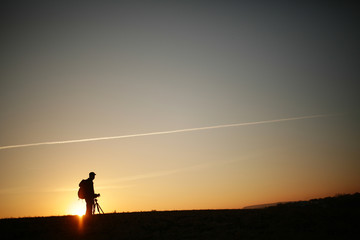 Silhouette of a photographer during the sunset.