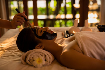 Asian women are doing spa has massage her skin to mask the early morning hours