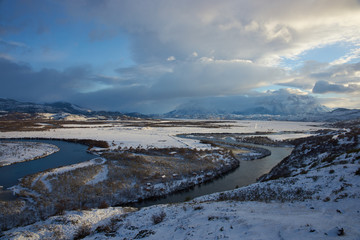 Winter landscape of lakes and snow covered hills and mountains in Torres del Paine National Park in Patagonia, Chile.