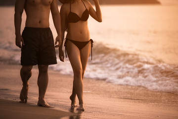 Couple walking holiday Evening at the beach During the summer