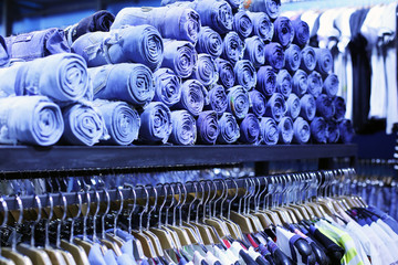 jeans laid out on the shelves in stores