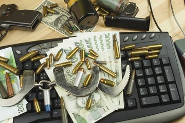 Internet illegal arms trade. Merchant arrest illegal ammunition. Internet crime. Current euro banknotes and Czech koruna.