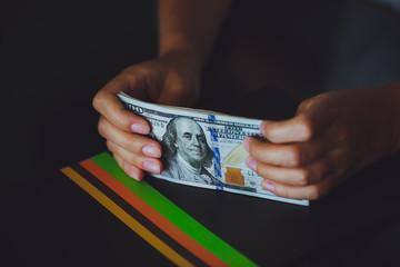 Money in human hands, women dollars