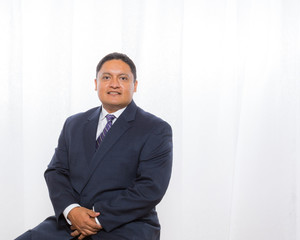 Professional Hispanic Male In Suit With Confident Expression