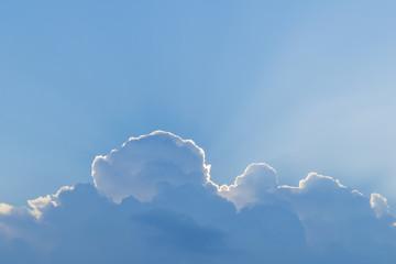 sunbeams over-clouds on blue sky background