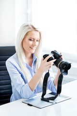 Young, attractive and confident woman working in office. Retouch