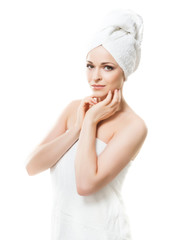 Attractive girl in towel isolated on white. Spa, wellness and health care concept.