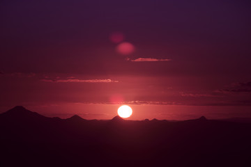 Silhouette of the sun and the mountains. View from Mount Tamborine.