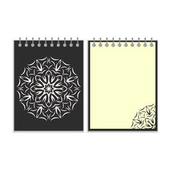 Black cover notebook with round florwer pattern
