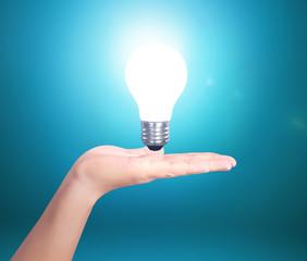 Creative light bulb idea in the hand