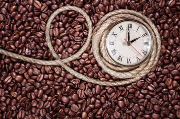 Retro clock on a coffee background