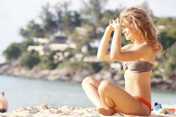 blonde sunbathing on the beach