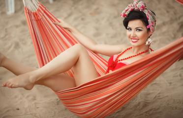 Beautiful young woman bikini girl at beach pinup style