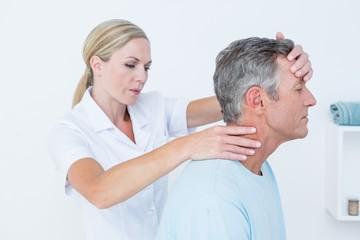 Doctor doing neck adjustment