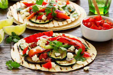 Vegetarian snack tacos with grilled vegetables and salsa.