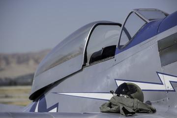 Vintage fighter pilot's helmet and cockpit.