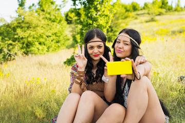 Two happy boho girls taking a selfie