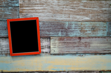 Red wooden frame hanging on a wooden board