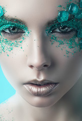 close-up portrait of turquoise woman