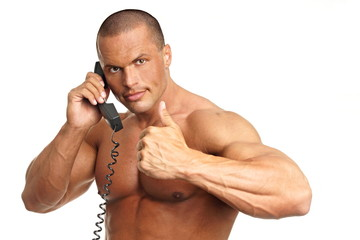 Handsome muscular man call with phone and shows you thumb up