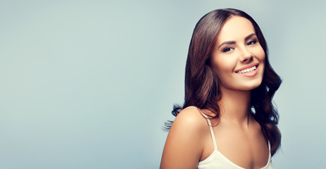 happy smiling young brunette woman, with copyspace