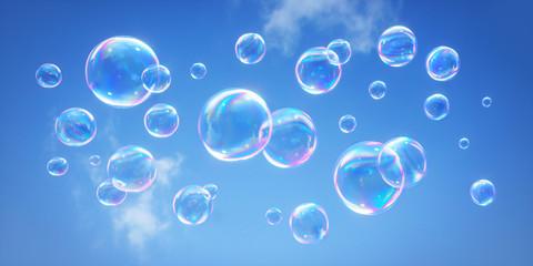 Seifenblasen vor blauem Himmel