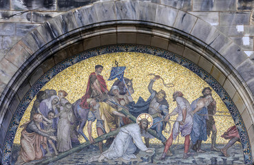 Christian icon of Christ beating on the facade of Bremen church