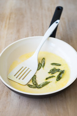 Fried Sage Leaves and Butter in a Ceramic Pan