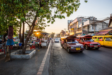 Chian Mai city market with street and traffic in the evening with sunbeam
