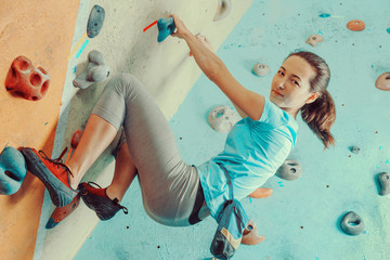 Woman training in climbing gym
