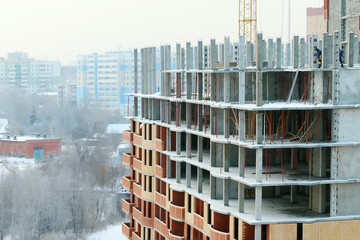 Construction of apartment building in yellow and red bricks