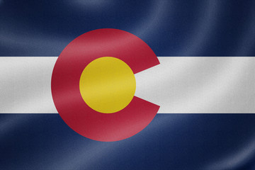 Colorado flag on the fabric texture background