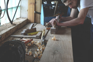 Woodworker while working in the studio