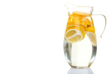 Lemonade in a jug on a white background isolated