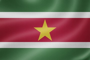 Suriname flag on the fabric texture background