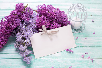 Background with  lilac flowers  and tag