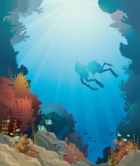 Coral reef, underwater cave and divers.
