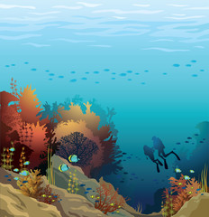 Coral reef and silhouette of divers.
