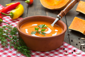 Pumpkin soup with cream and chilli peppers