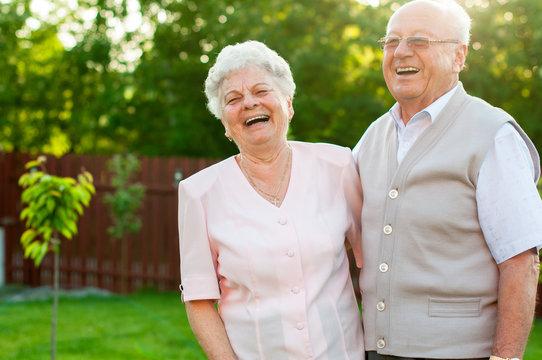 Happy senior woman and man
