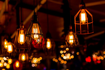 Retro interior light bulb glowing.