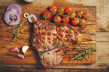 Fiorentina steak grilled with spices and vegetables on a rustic