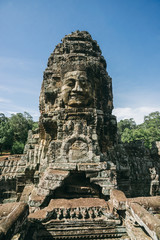 A giant stone statue from the ancient temples of Angkor, which is one of the most important archaeological sites in the world.