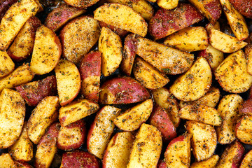 Roasted potatoes with rosemary and spices. Ready to cook Background, texture.