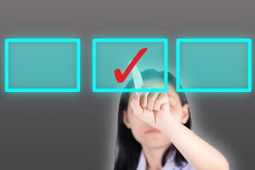 Girl pushing tick symbol  button with computor screen
