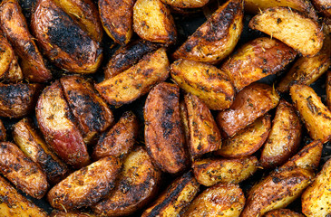 Roasted potatoes with rosemary and spices. Ready to eat. Background, texture