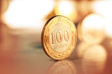 Kazakh money - Tenge/ 100 tenge (Kazakh money) lie at the edge of the table
