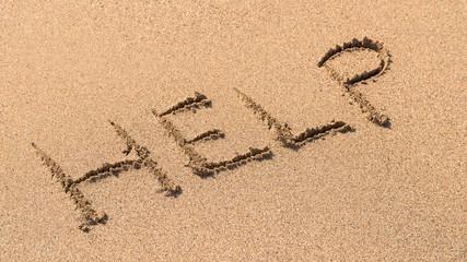 Help Sign Drawn On Beach Sand