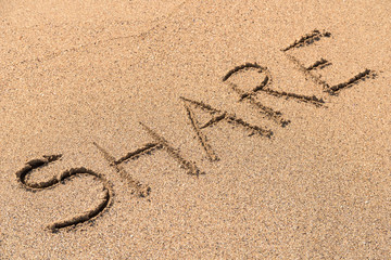 Share Sign On Beach Sand