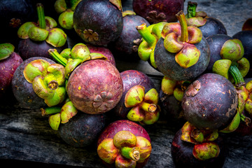 Mangosteen on wood background,colorful of fruit